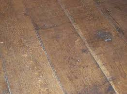 wide reclaimed oak was sawn to these wide boards laid in a Cumbrian cottage  with a ...