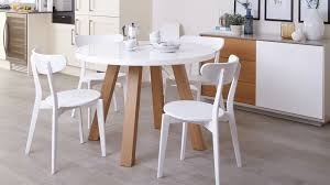 four seater round dining table with white gloss top and wood veneer legs exclusively danetti julia