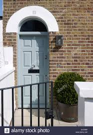 front door lightTraditional iron gate and light blue panelled front door