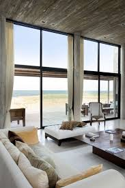 Beach house with modern interior design. Concrete blocks insure a high  level of privacy.
