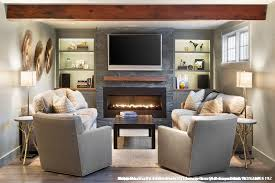 stackable stone fireplace with built ins on each side for traditional living room and swivel chair