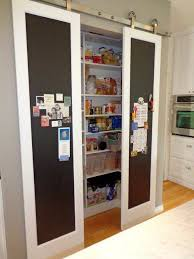 sliding pantry door with chalkboard face slimmer door profile plus e to display and or write stuff on the wall so useful