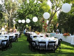 outdoor backyard unique wedding decorations with round tables and black wooden chairs also white chinese lanterns
