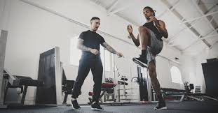 a fitness coach and a personal trainer