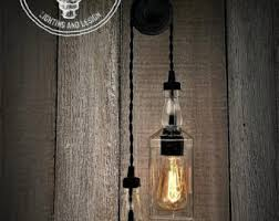 Industrial home lighting Trendy Industrial Upcycled Whiskey Double Pulley Lighting Edison Lighting Industrial Lighting Whiskey Bottle Lighting Home Decor Upcycled Etsy Industrial Lighting Etsy