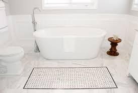 white marble flooring for bathroom with freestanding bathtub and floor faucet also anti slip mat