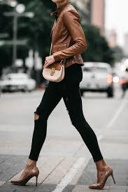 tan leather moto jacket black ripped skinny jeans outfit chloe drew handbag louboutin pumps