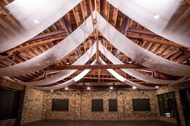 ceiling up lighting. includes 8 panels of ivory chiffon ceiling drape 2 bar uplights for altar and 10 walls trophy room only up lighting
