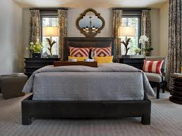 beautiful masculine master bedroom ideas with grey bedding set and stripes red cushions also unique frame wall mirror plus glass flower vase and fl