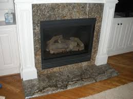 image result for granite fireplace