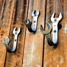 hooks wrenches in the wooden wall cool man cave decor and furniture ideas to try