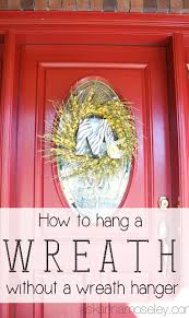 how to hang a wreath on a glass door