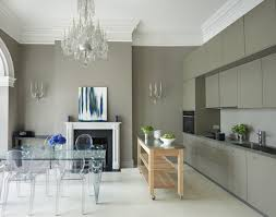 grey and white kitchen with crystal chandelier