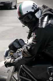 can t get cooler than an open faced helmet with dark goggles and leather