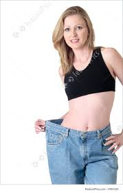 Weight Loss For Women Losing Weight Images For Weight Loss Woman Demonstrating Weight Loss By Wearing An Old Pair Of Jeans Four Sizes Too Big