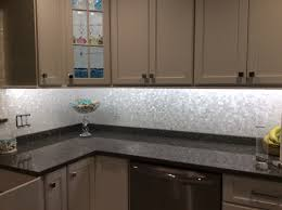 groutless mother of pearl shell tile kitchen backsplash