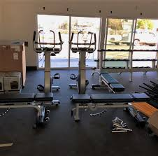 transmotion delivered and embled two 8ub upright bikes three nautilus multi adjule benches along with a nautilus triple dumbbell rack for carondelet