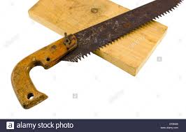 wood hand saw. stock photo - retro rusty hand saw and wood board part on white
