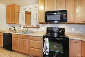 Colored Kitchen Appliances Light Color Kitchen With Black Appliances Stock Photo Picture And