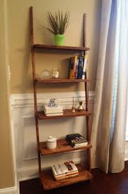 Breathtaking Brown Wooden Ladder Shelf For Crafts Display And Storage As  Well As White Wainscoting In Traditional Living Room Ideas