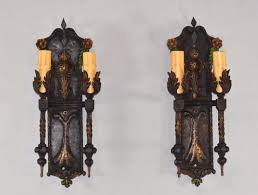 pair of gothic revival iron wall sconces hammered