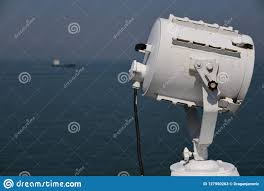 Vessel At Anchor Lights Search Light And A Ship In The Distance Stock Image Image