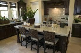 dark cabinets light countertops dark wood cabinet kitchen with light granite counter and rattan bar stools