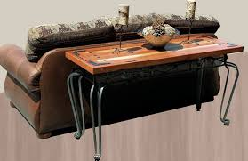 wrought iron and wood furniture. classic wrought iron sofa table with hard wooden material decorated behind the and adorned wood furniture
