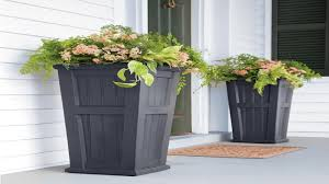 Decor: Tall Outdoor Planters And Doormat With Front Entry Door