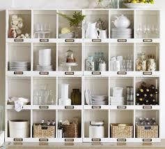 kitchen space above kitchen cabinets dark counter red disk rack grey granite countertop white wooden