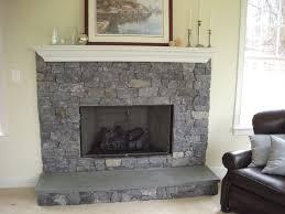 grey castle irregular stone indoor fireplace
