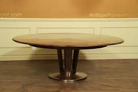 expandable table with self storing leaves solid walnut with brass accentodern style