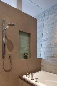 hansgrohe bathtub shower. chic hansgrohe shower in bathroom san francisco with stacked stone tile next to separate tub and bathtub madebymood.com