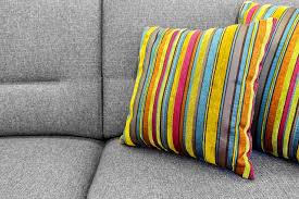 gray sofa with colorful striped pillows