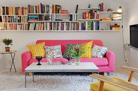 Simple But Comfy Small Living Room With Shocking Pink Sofa And Wall Bookshelf  Idea