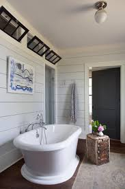 modern farmhouse with gray shiplap walls and freestanding tub