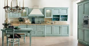 classic kitchen decor using blue cabinets color and wooden chimney