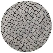 painstaking lessons of round grey rug