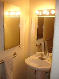 bathroom inspiration modish white single wall mounted sink and mirror also amazing fixture wall lights on bathroom lighting ideas small bathrooms