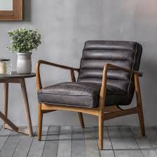 retro style leather armchair upholstered in a weathered black leather within an ash wooden frame