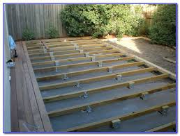 floating deck over concrete patio flush ground level deck how to