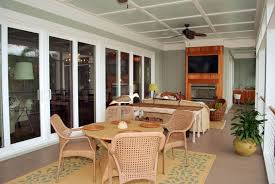 image of this sunroom has multiple entrances from the interior the light hardwood floor