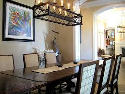 rustic black rectangle chandelier over traditional dining set in dining room lighting ideas