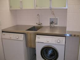 ... Laundry Room Shelving with Washing Machine Under Green Cabinet and  Cream Wall Ceramic ...