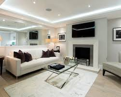 Contemporary formal light wood floor living room idea in London with gray  walls, a standard