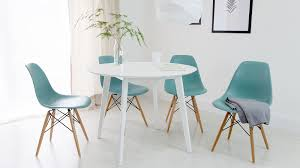 white round four seater dining table