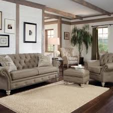 rustic modern living room with light brown tufted sofa chair and ottoman table with wooden legs hardwood floor tiles and white brick wall design ideas