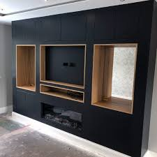 wood framed black cabinets tv wall ideas