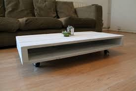 Image of: Mid Round Coffee Table With Wheels