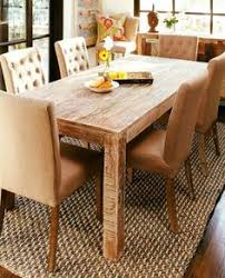 our hton farmhouse dining room table crafted from reclaimed teak wood that has been reclaimed from old buildings with a distressed lime wash finished